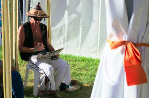 Raiden takes some time out between rounds to check the programme - Woodford 2015