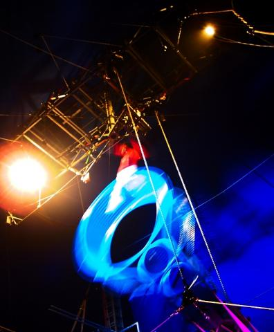 A performer on the Wheel of Death - taken at a small touring circus in July 2004.