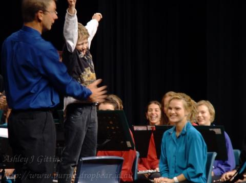 A young Maestro-in-training (selected from the Audience on the night) takes his bow after conducting the Senior Concert Band at The Gap State High School's <i>Cabaret Night</i>.