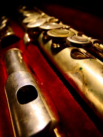 This flute has been played so much that the Silver Plate has worn off and tarnished in many places.