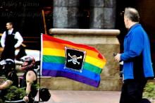 He lowers his binoculars - the pirates are much closer than they first appeared!