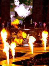 From Robbie Williams' second Brisbane concert, 14th December 2006. That's Robbie in his Adidas hoodie near the drumkit. I can only imagine what it was like to be right next to those flamethrowers when